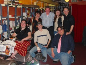 Sharon and Gadget pose with several authors in a bookstore