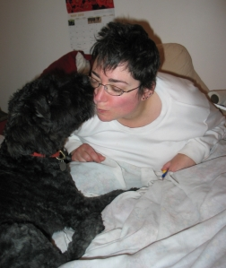 Barnum at 5 months kissing Sharon on bed