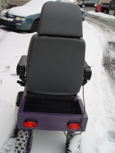 Rear view of purple power chair