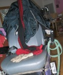 Powerchair covered with cold weather gear