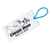 "A box clicker, blue on top and white underneath. The bottom has a cartoon of a dog creeping toward a starting line and the words, ""Clean Run"" underneath with the company phone number. At the top end of the clicker is a blue elastic band, the same kind as a hair elastic."