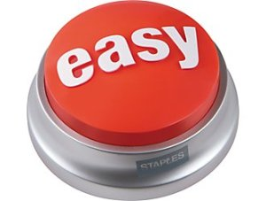 "Round raised bright red button says ""Easy"" in white letters on the top. The base is metal and says, ""Staples"" on one side."
