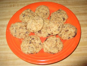 Close-up view from above of Gluten-Free Vegan Chocolate Chip Cookies on an orange plate