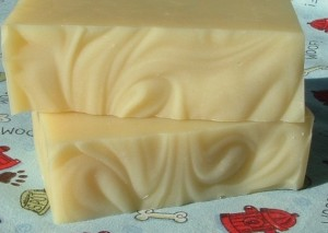 Two thick bars of a yellow soap with swirls on the top. The color of lemon meringue pie.