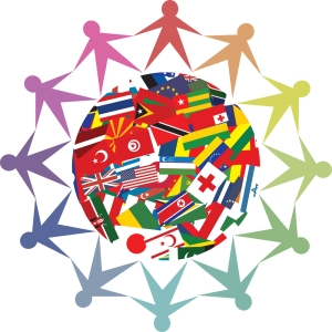 A globe brightly covered with the colorful flags of all nations and people that look like paper dolls standing in a circle around the globe holding hands. The 12 people are each a different shade of the rainbow, from red to purple.